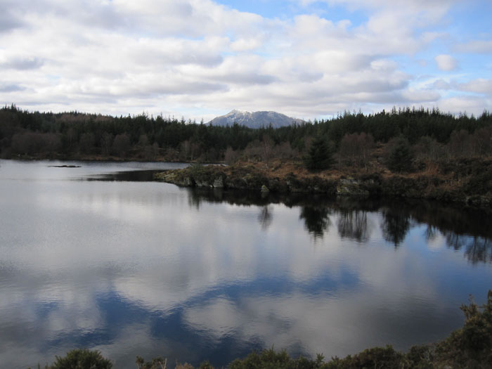 The sky reflected in the waters of Elsie Lake in Snowdonia National Park