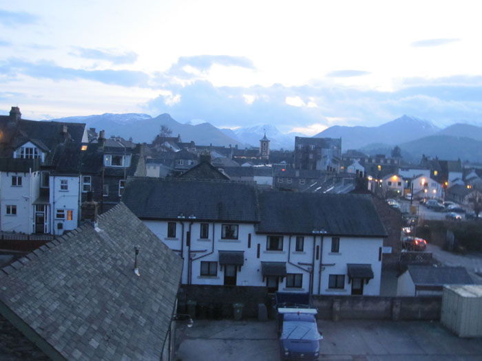 Quaint Keswick at dusk with the backdrop of the mountains