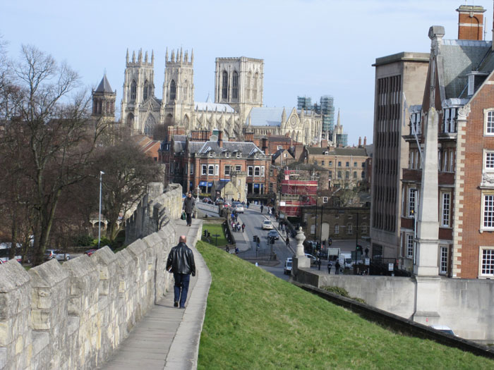 Walking along the city walls near the rail station, Minster in view