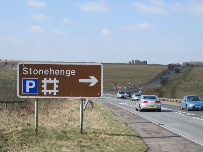 "Stonehenge near the intersection of the A303 and A344 ""dual carriageways"" (highways to Americans)"
