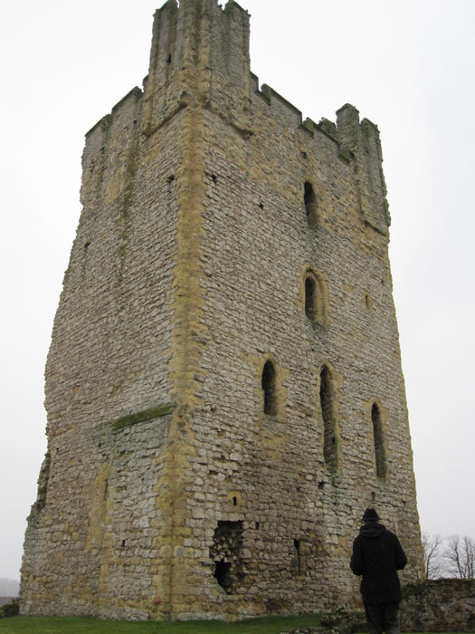 Dean with his super-cool hat standing below the one remaining tower at the ruins of Helmsley Castle