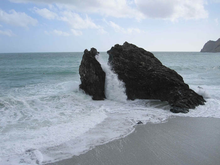 The waves crashing on the shore at Monterosso al Mare