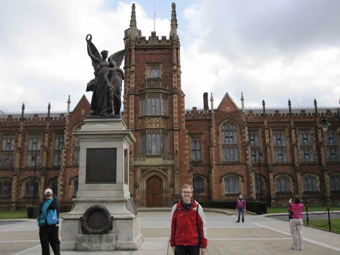 Me standing in front of Queen's University of Belfast