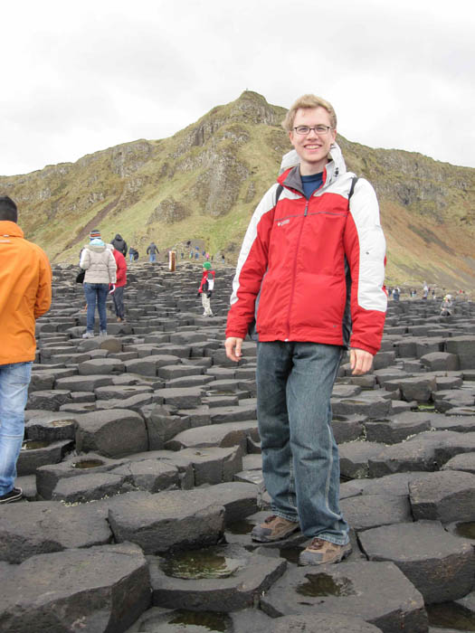 Me braving the strong wind gusts at Giant's Causeway - do I look like Finn MacCool or no?