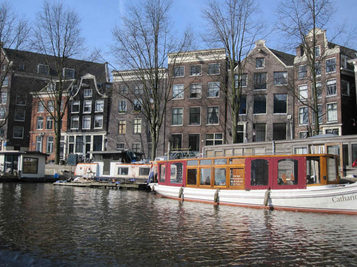 Grachtenhuizen and house boats along Amsterdam canals