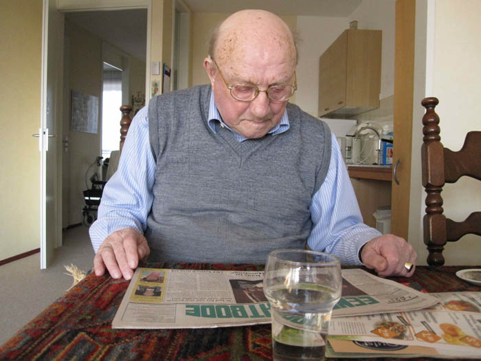 Opa reading the local newspaper, or krant