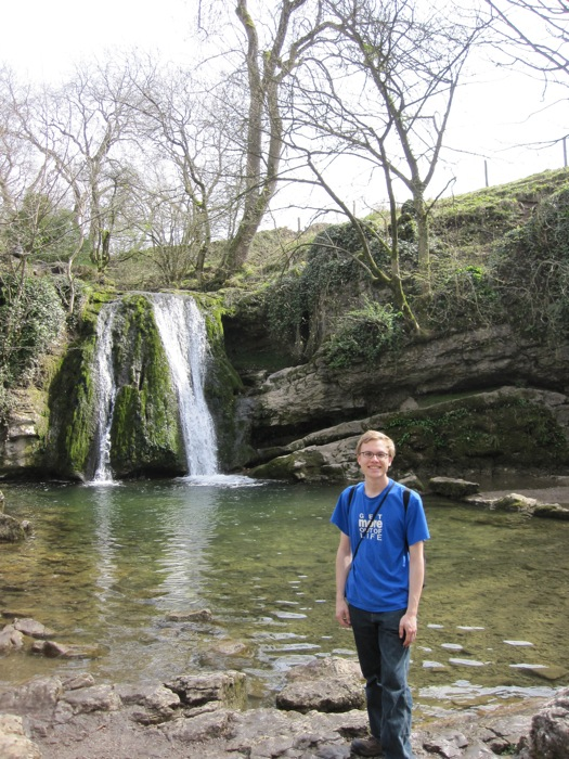 Me by a gentle waterfall and pool at the end of the glen