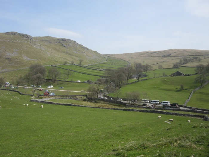 Fields are partitioned by stone walls and go up the hills
