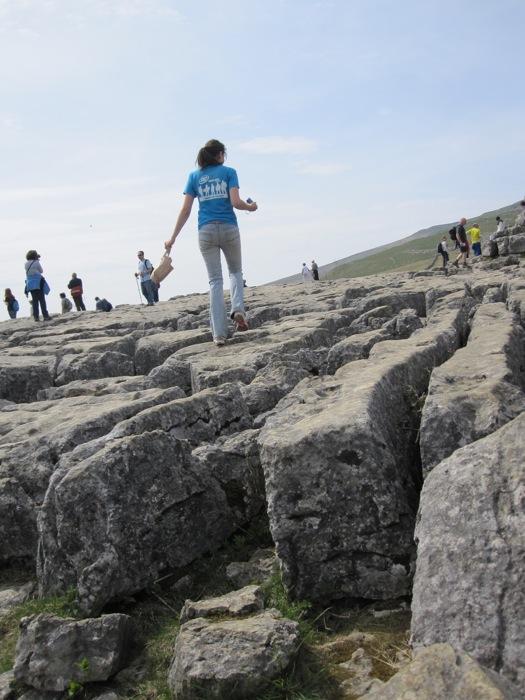 Jennifer C. walks on the wobbly limestone