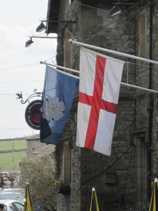The English flag with St George's cross and the Yorkshire flag with the White Rose of York (in Malham)
