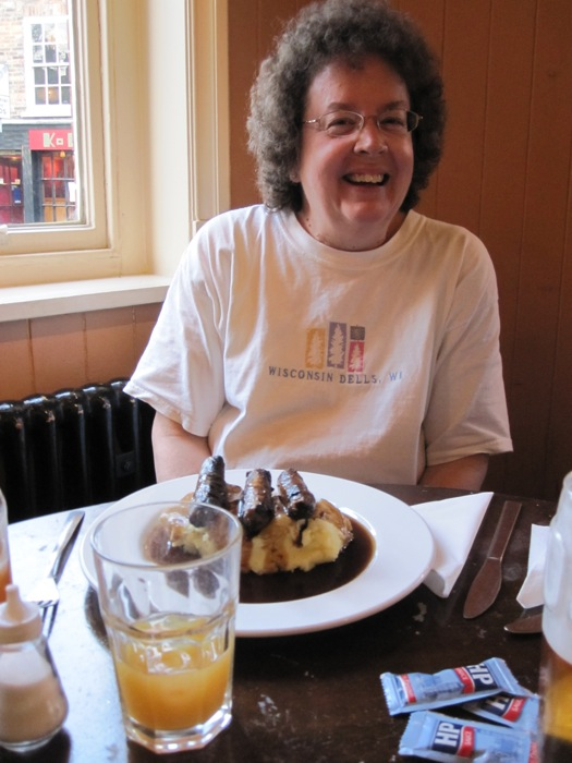 Mom laughing and enjoying her bangers and mash at Cross Keys