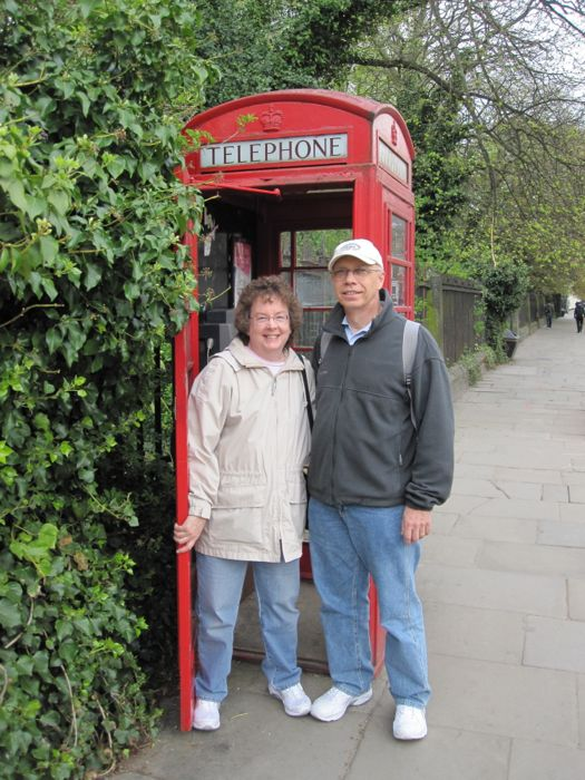 Mom and Dad in a classic red telephone booth