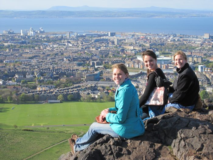 Eva, Jennifer C., and Geri atop Arthur's Peak with Firth of Forth in the distance