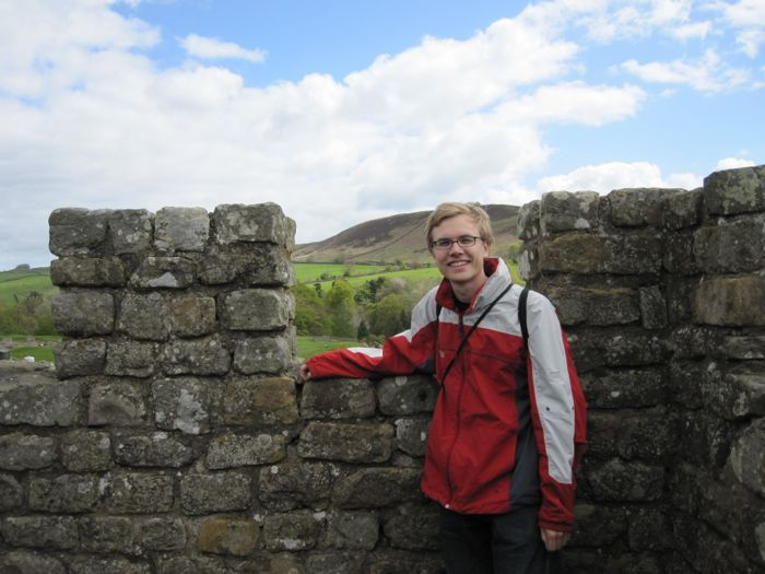Me on a rebuilt section of the wall or fort at Vindolanda