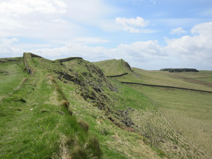 Hadrian's Wall streches out before me on the craggy cliff